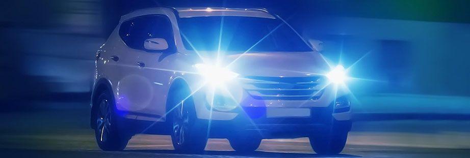 White car night headlights