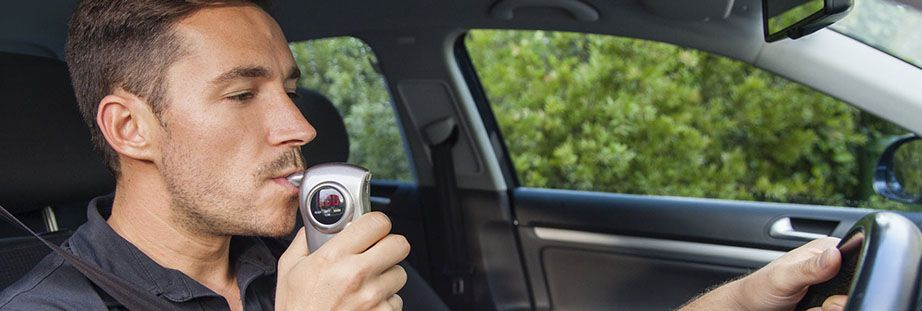 Man using breathalyzer