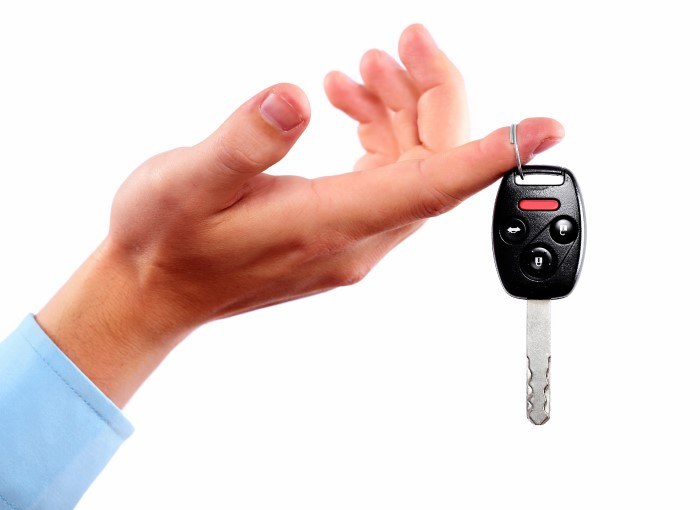 Hand holding car key