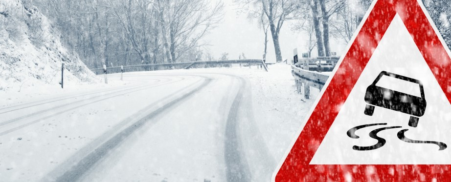 Snowy road with traffic warning sign