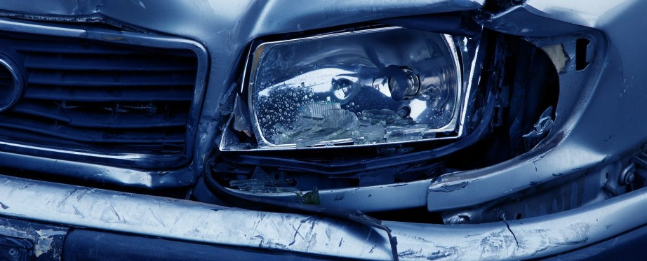 Headlamp on dented car